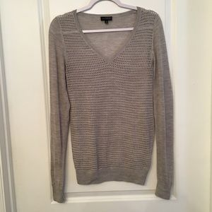 The limited gray eyelet sweater size XS